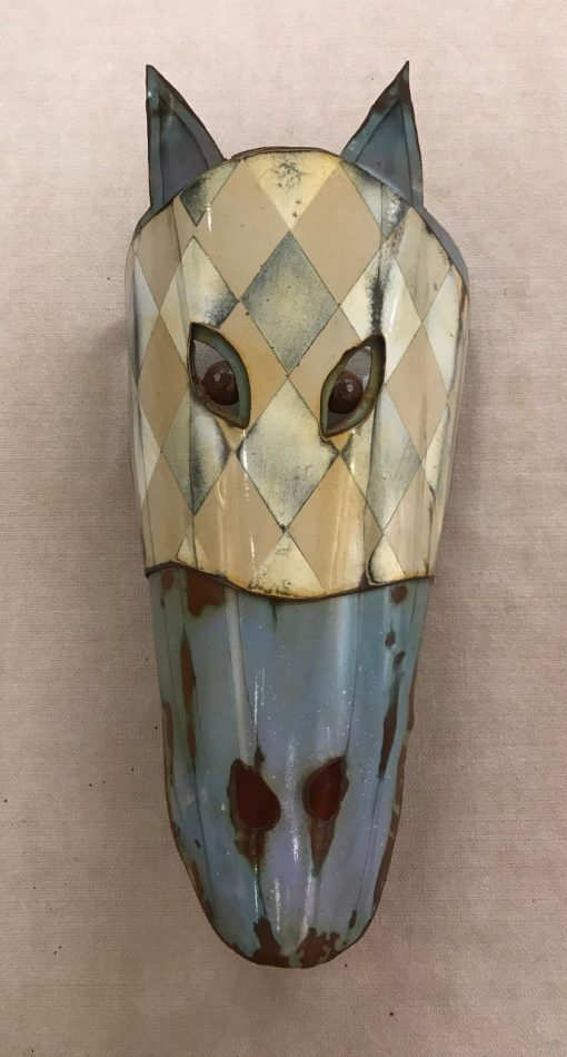a horse head made of recycled metals. blue and cream colored. Round, brown eyes. Pointy blue ears.
