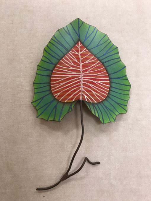 Metal Leaf sculpture, ready to hang. A red and white center, with a green and blue boarder. A single brown stem extends from the bottom. Spade Shaped leaf.