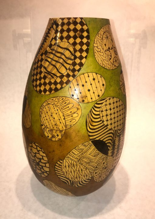 tall skinny gourd handpainted base color of chartreuse with handpainted black and light green geometric patterns