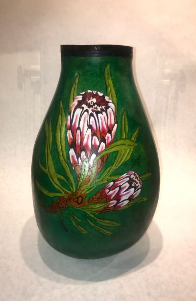 tall skiny dark green dyed gourd handpainted with pink and red protea flower with light green leaves