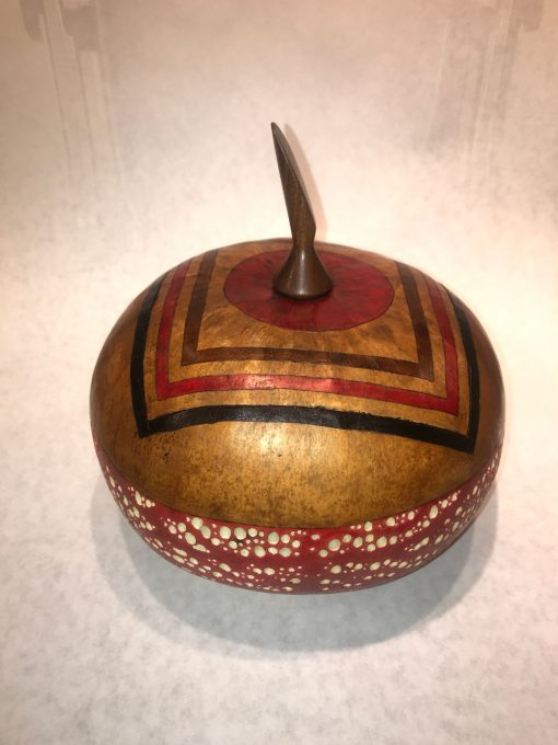 short wide round hand dyed red bottom with bubble motif tan lid with knife shaped handel and geometric design by Maui local artsit Jaz Staley