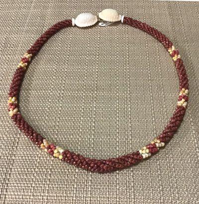 "Ni'ihau Lei, 20"" 4-Tie Poepoe with 14K gold-filled clasp. Created by master artisan Maile Kanahele."
