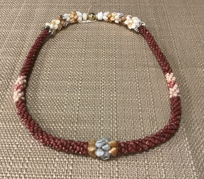 Ni'ihau lei, 19″ 4-tie Poepoe with Pikake Momi. Created by master artisan Kanani Puo.