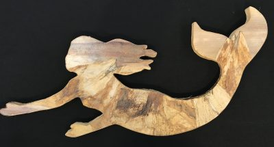 Mermaid wall hanging from the mind of Baz Cumberbatch. He carves the background from wood, then adds layers of natural fibers by hand