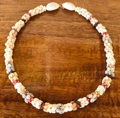 """Ni'hau Lei, 19"""" Coconut Poepoe with 14K gold-filled clasp. Created by master artisan Debbie Kanahele."""