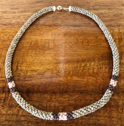 "Ni'hau Lei, 18"" Poepoe with 14K gold-filled clasp. Created by master artisan Uilani Kanahele."